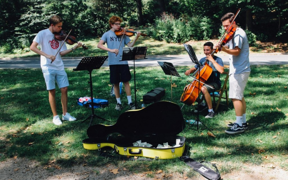 A group of NYU students perform music at Central Park in New York. Luke Galati Photography.