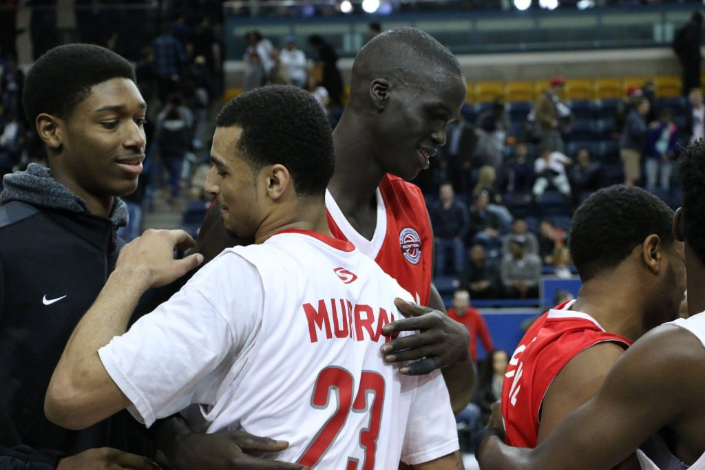 Jamal Murray and Thon Maker embrace at centre court at the first ever BioSteel All-Canadian Game at the Mattamy Athletic Centre. Luke Galati Photography/The Eyeopener