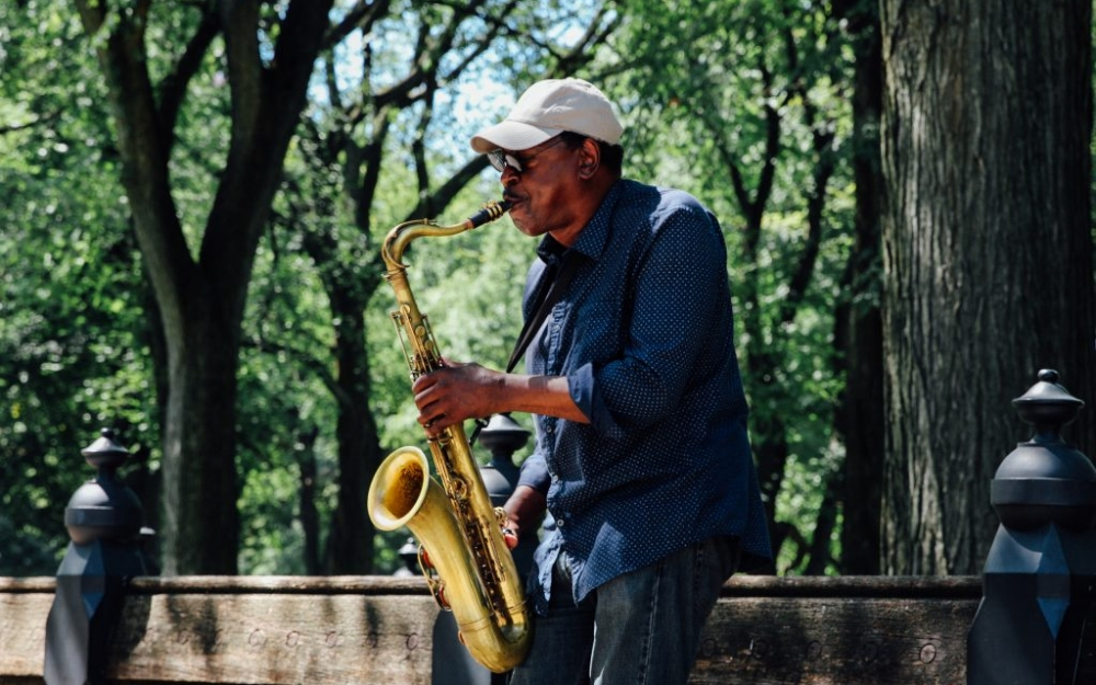 A man plays the saxophone in New York City's Central Park. Photo by Luke Galati