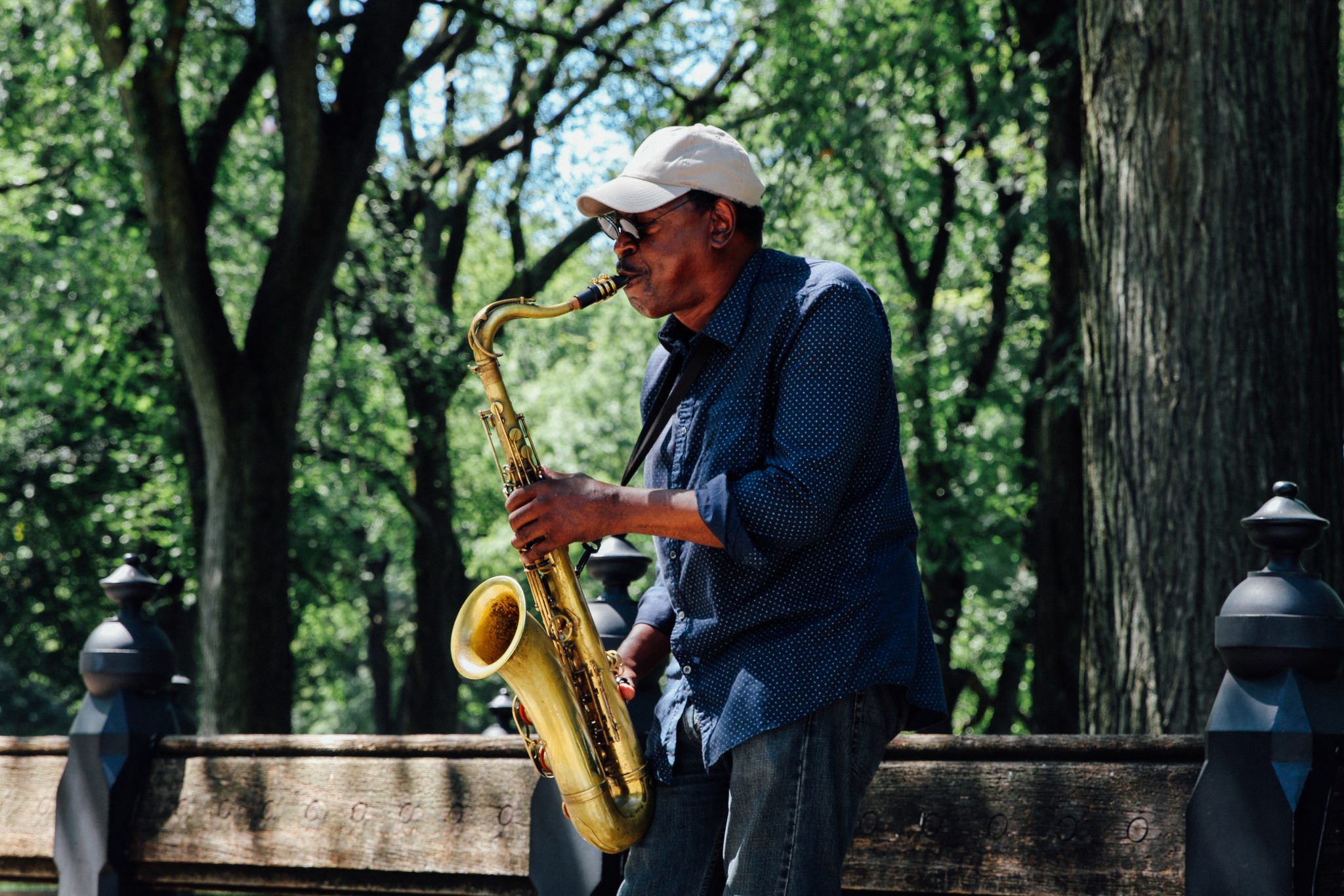 A man plays the saxophone at Central Park during the summer of 2016. Luke Galati Photography
