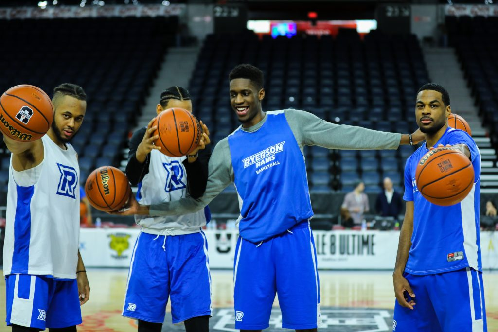 A portrait of the Ryerson Rams Men's Basketball team, Chase Vassell, Theodrose Demeke, Keevon Small and Adika Peter-McNeilly