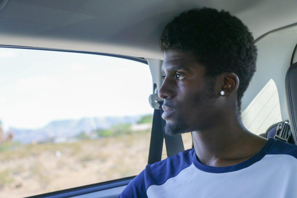 Christian Williams looks outside the window at the Las Vegas desert. Shot by Luke Galati/King Nation Basketball