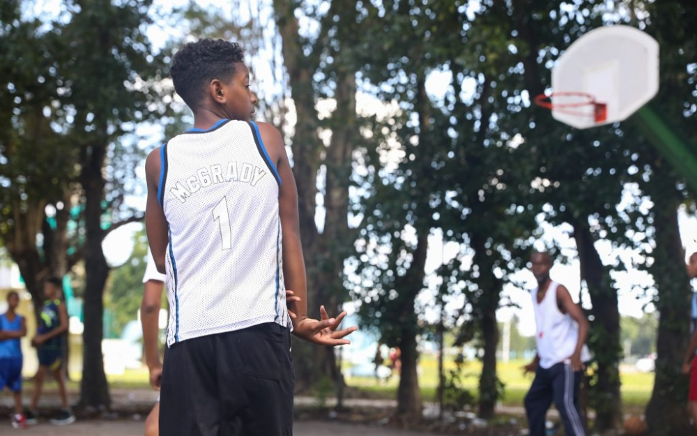 A basketball player in Havana, Cuba wearing a Tracy McGrady basketball jersey. Photo by Luke Galati