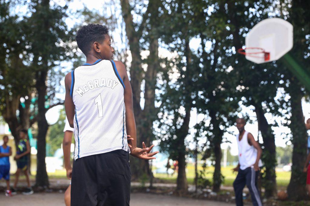 A basketball player in Havana, Cuba wearing a Tracy McGrady basketball jersey. Photo by Luke Galati