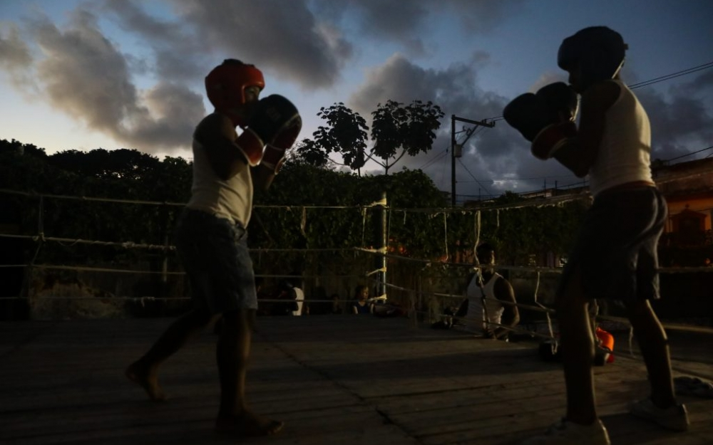 Two young boxers on Soledad Street at Gimnasio de Boxeo Centro Habana. Photography by Luke Galati in Havana Cuba, 2017