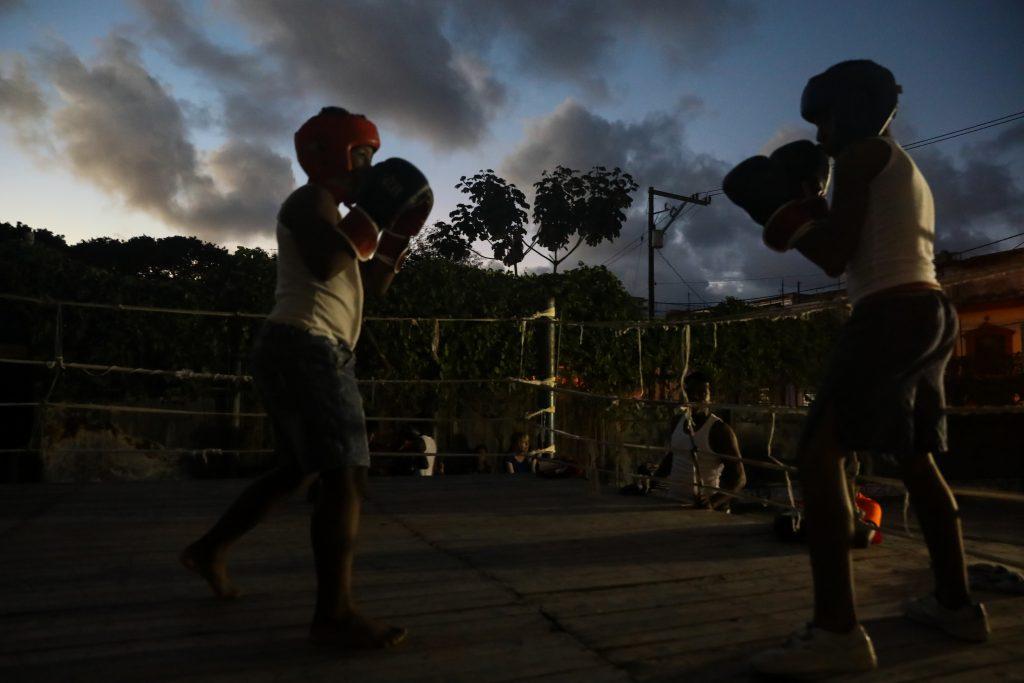 Two young boxers on Soledad Street at Gimnasio de Boxeo Centro Habana. Photography by Luke Galati in Havana Cuba, 2017