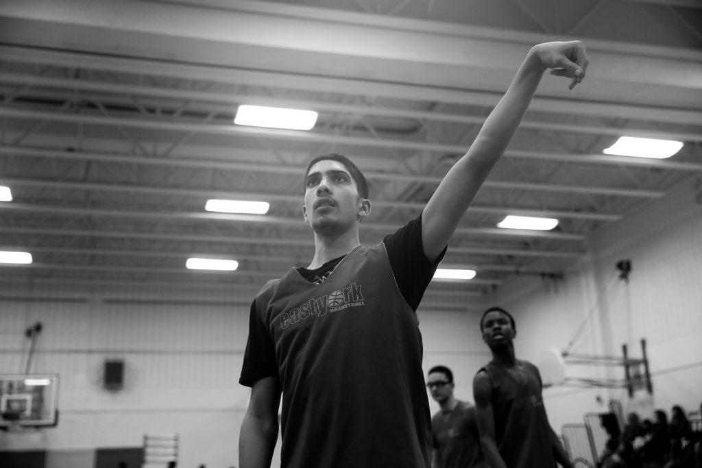 Danial Ahmed takes a jump shot during warmups. Luke Galati Photography