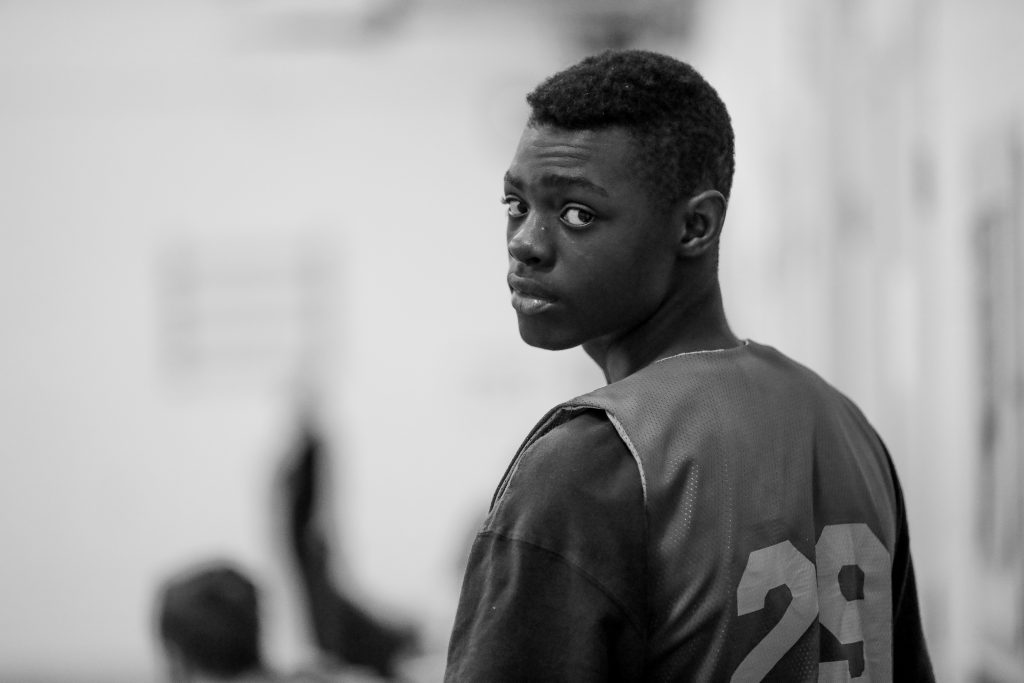 Eat York basketball player, Jeff, 15, before he substitutes into the game. Luke Galati Photography