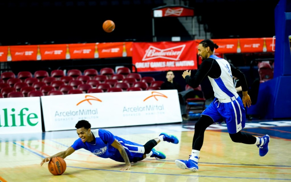 Ryerson Rams guard, Myles Charvis dives for a loose ball beside Theodrose Demeke during practice in Halifax at the Usports Canadian basketball finals.