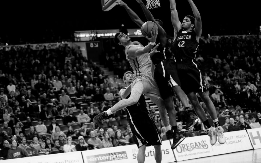 Ryerson Ram, Ammanuel Diressa scores the incredible layup around three defenders in the national championship game in Halifax. Luke Galati/The Ryersonian