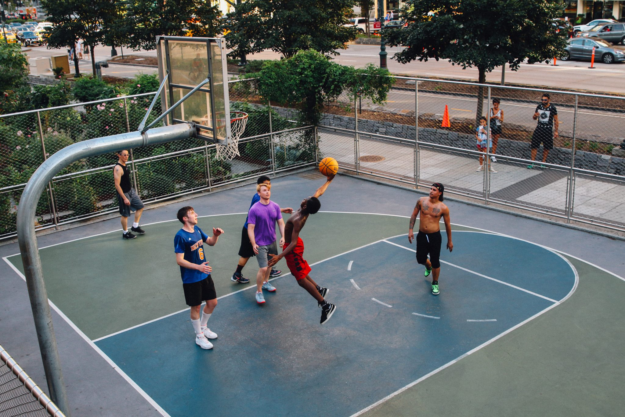 A game of pick-up basketball in Lower Manhatten. Luke Galati Photography in NYC
