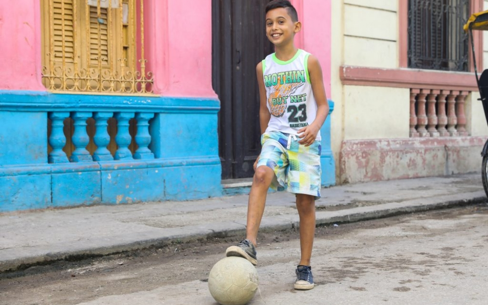 A boy in Central Havana playing soccer