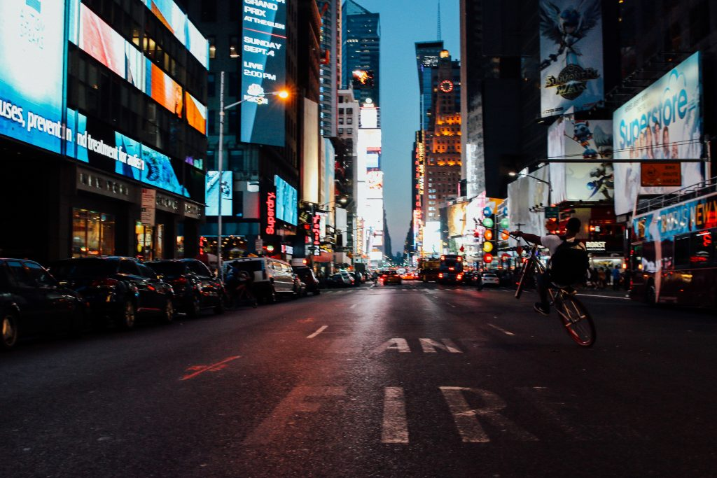 A young man riding down Times Square in New York City. Taken by Luke Galati in NYC
