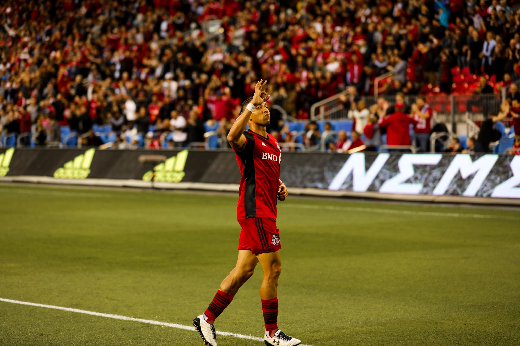 Justin Morrow scores against the Columbus Crew as TFC wins 5-0 and throws up the 6. Photography by Luke Galati/Toronto FC