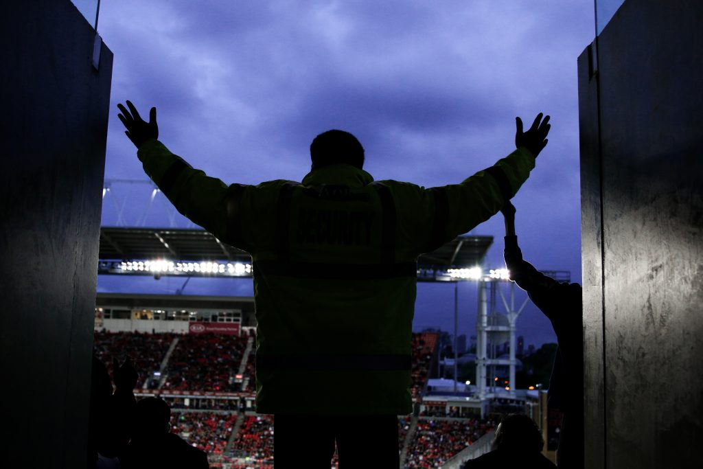 Toronto FC security guard gets in on the thunder clap at BMO Field as Toronto FC wins 5-0 against the Columbus Crew. Toronto FC/Luke Galati