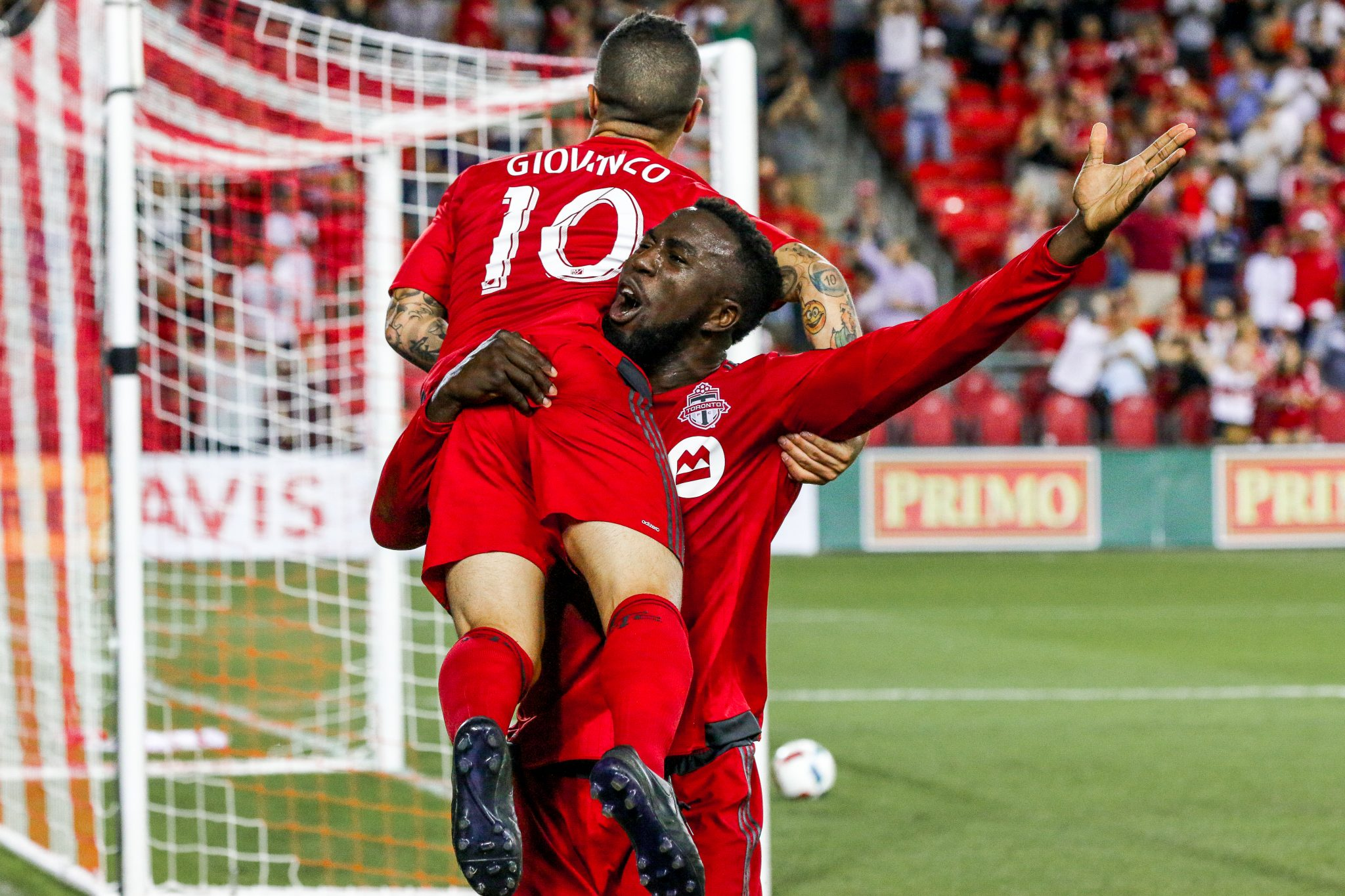 Sebastian Giovinco is lifted in the air by Jozy Altidore after scoring at BMO Field. Shot by Luke Galati Photography