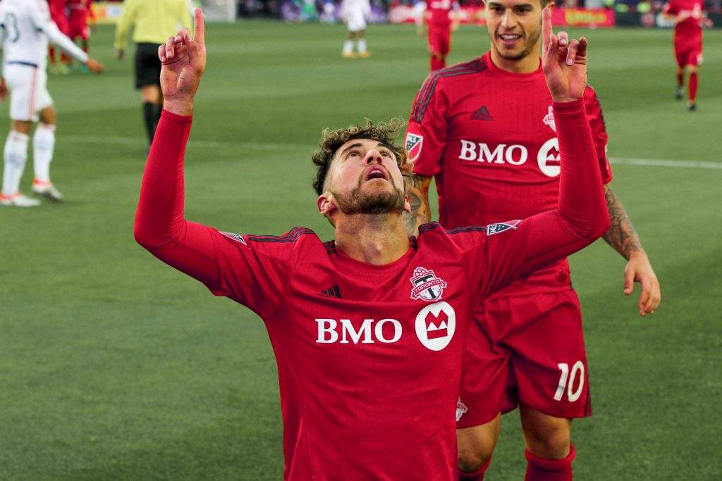 Jonathan Osorio celebrates pointing to the sky after scoring for Toronto FC.