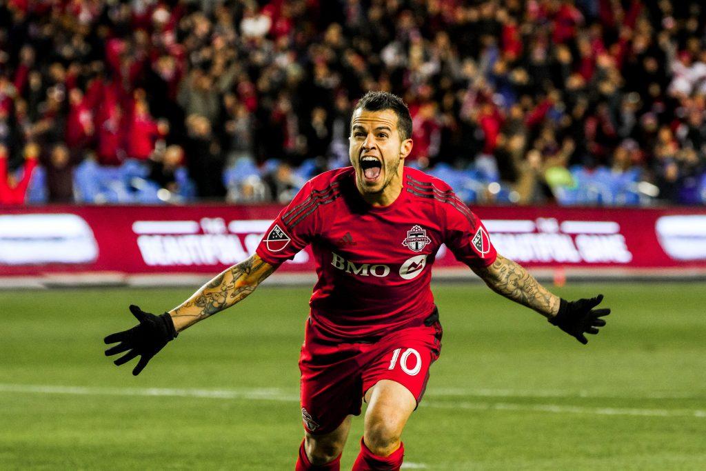 Sebastian Giovinco scores Toronto FC's first ever goal in playoff history. Photo by Luke Galati