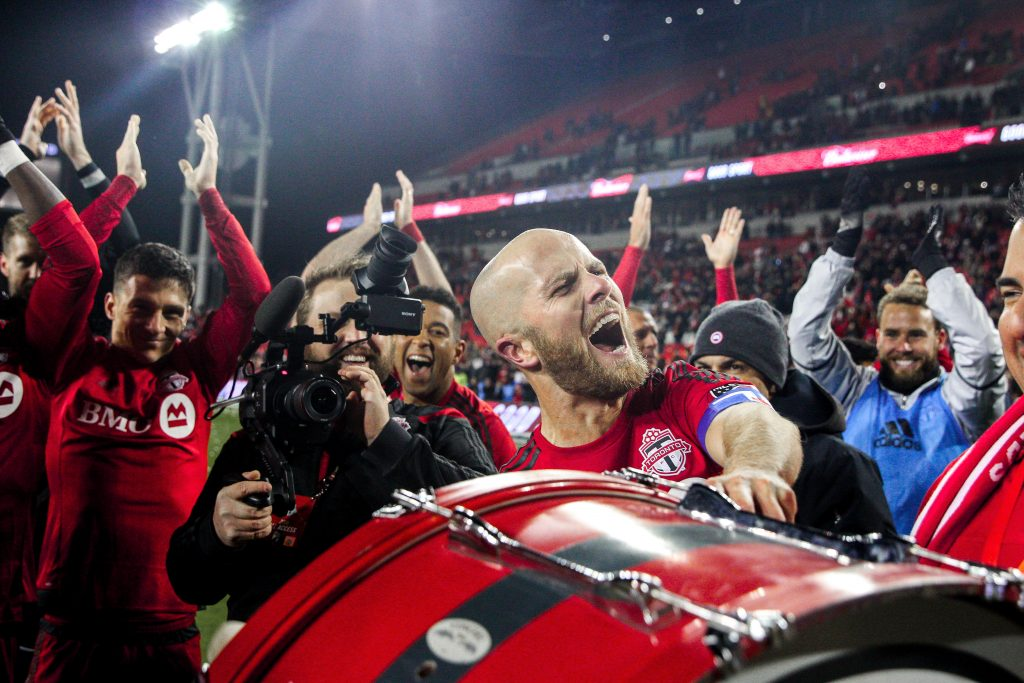 TFC captain, Michael Bradley, beats the drum with the fans in the supports section after Toronto FC's first ever playoff win. Luke Galati Photography/Waking the Red