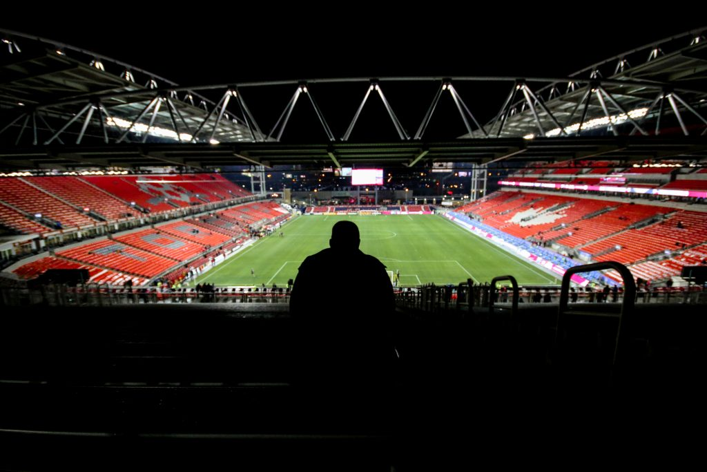 A fan waits in the temporary south end grandstand before an epic MLS Eastern Conference Championship against the Montreal Impact. Photo by Luke Galati