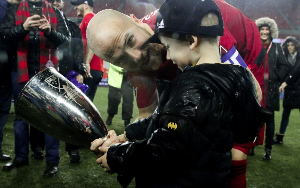 Michael Bradley and his son look at the Eastern Conference Championship trophy. Photo - Luke Galati Photography