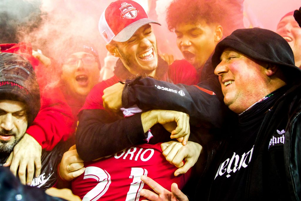 Nicholas Osorio and Jonathan Osorio celebrate after Toronto FC wins the Eastern Conference Finals against the Montreal Impact. Luke Galati Photography