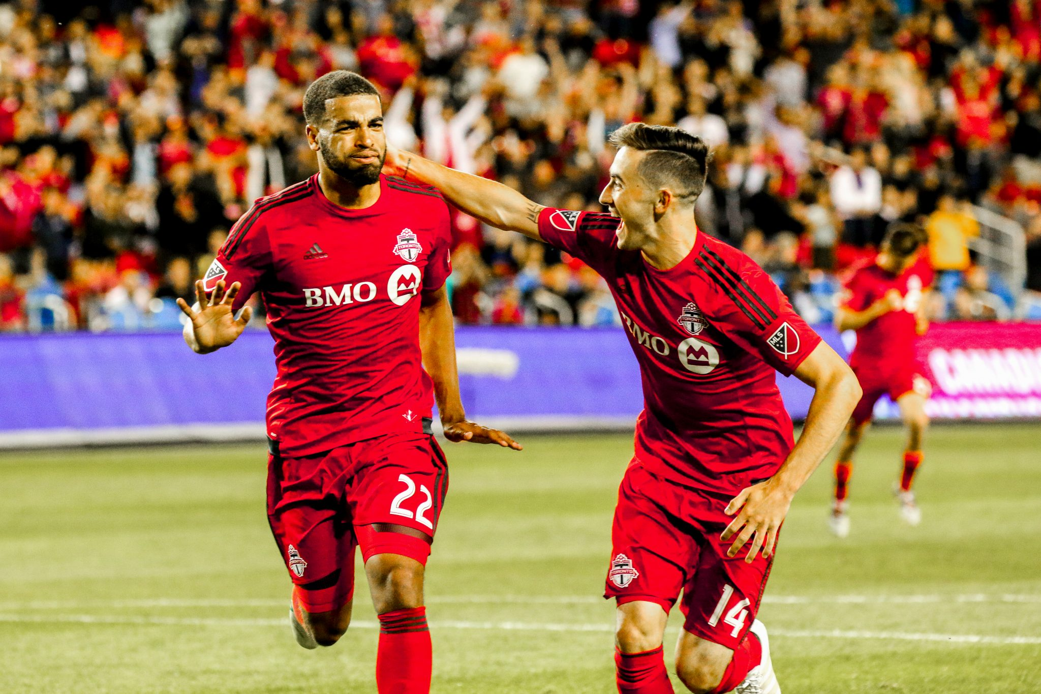 Jordan Hamilton and Jay Chapman celebrate after Hamilton scores two goals in the Amway Canadian Championship. Luke Galati Photography/Waking the Red