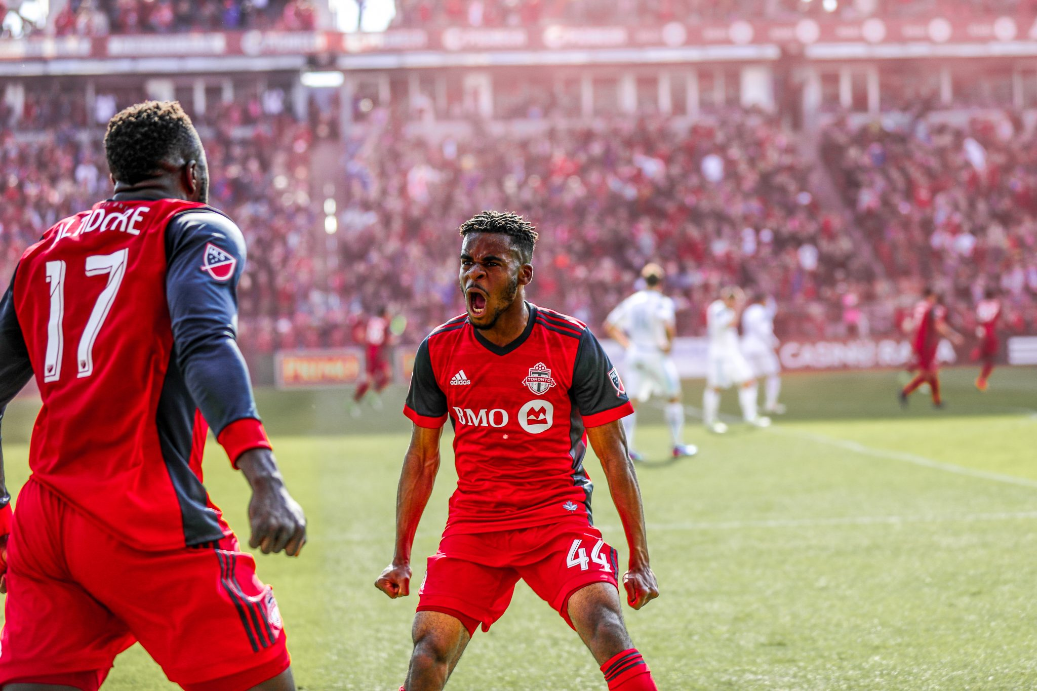 Raheem Edwards and Jozy Altidore get hyped after Tosaint Ricketts scores the game winner. Photo by Luke Galati for Toronto FC